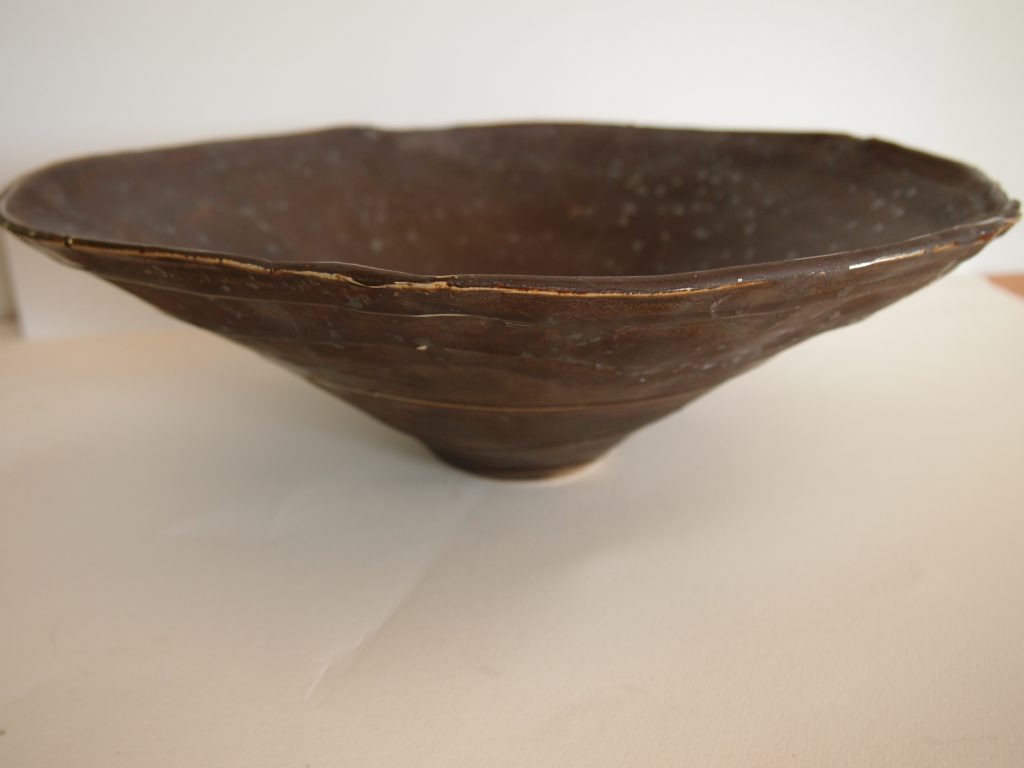 Altered and slip trailed bowl