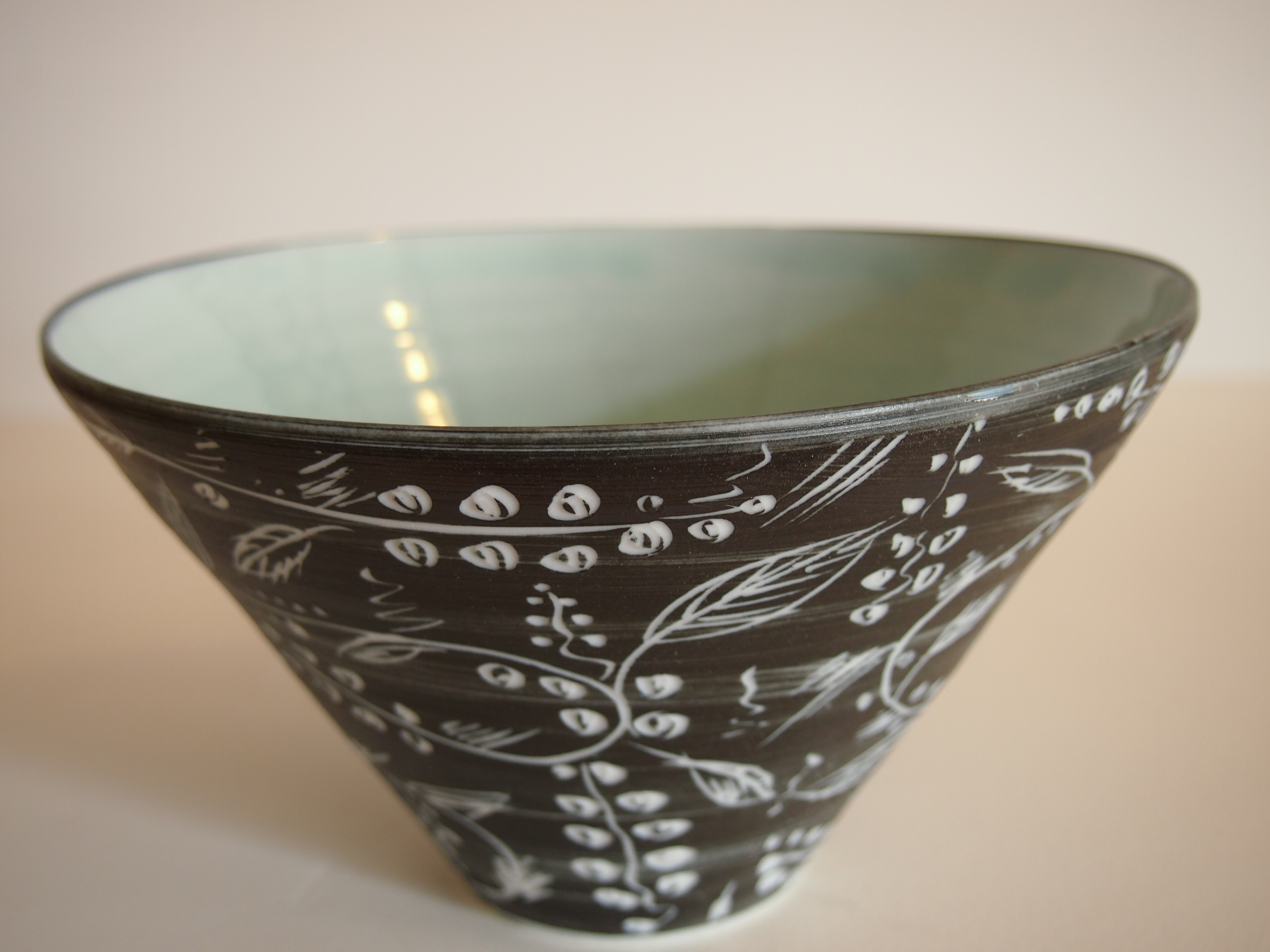 Black carved bowl with flowers