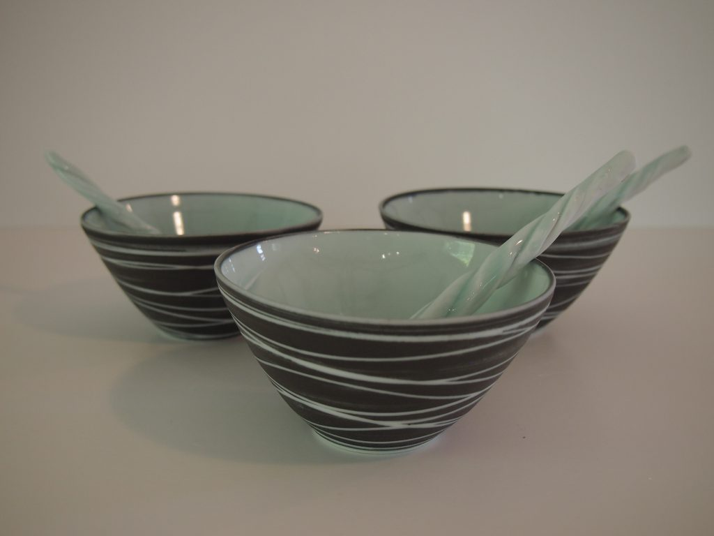 Black carved dipping bowl and spoon