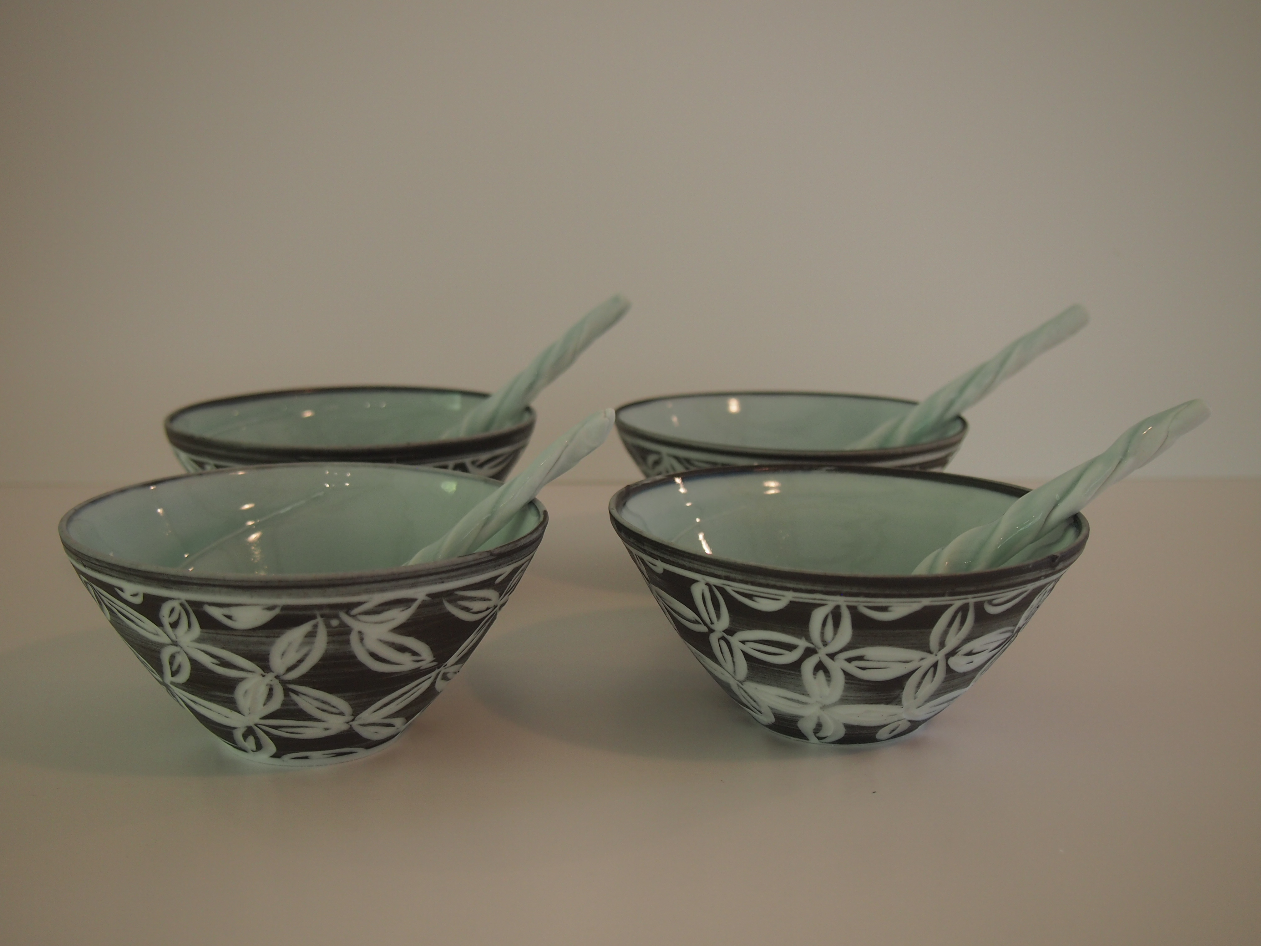 Black carved dipping bowls and spoon 10cm
