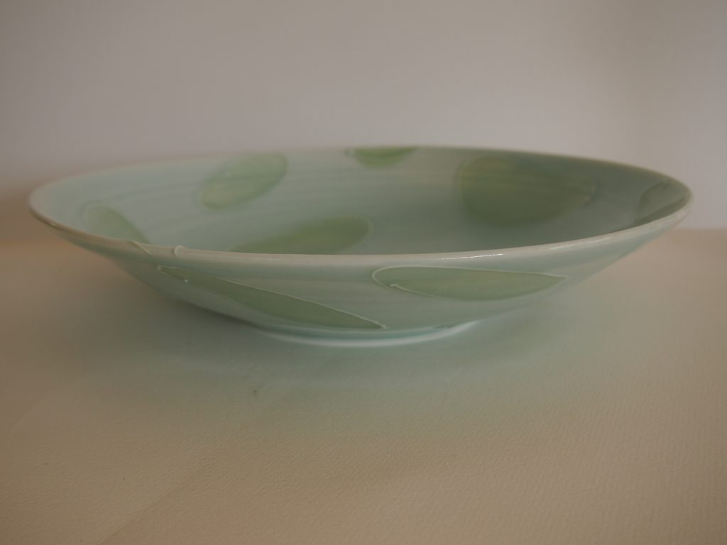 Double celadon bowl with slip trailed circles