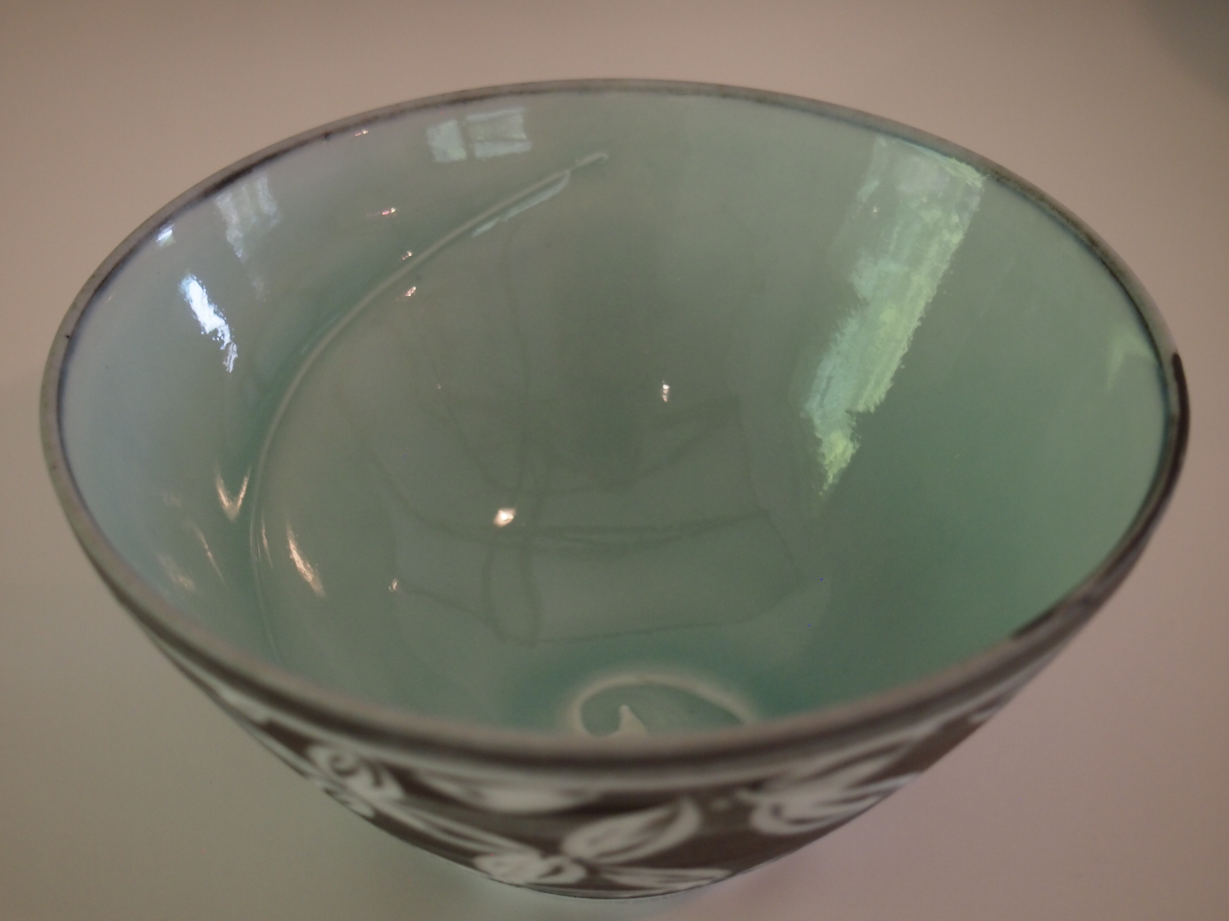 Inside view of black carved dipping bowl