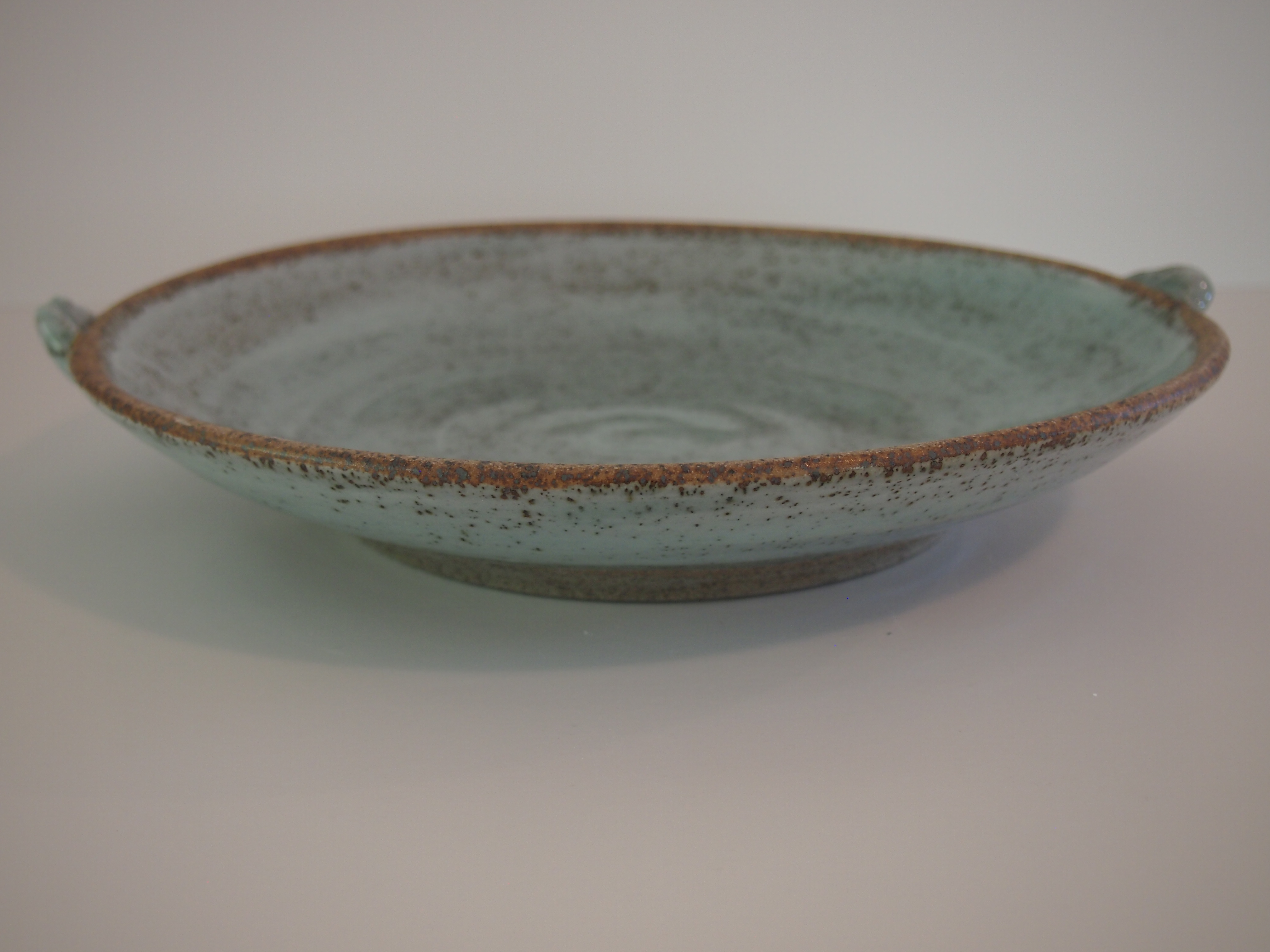 Slipped and glazed platter with handles